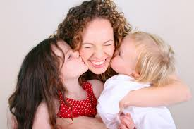 Children kissing mom